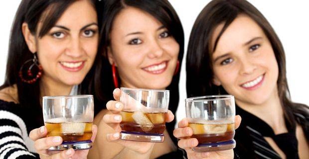 Three women with whisky on ice