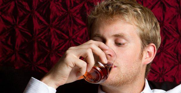 Peaty Nose Ltd: Man Drinking Scottish Malt Whisky
